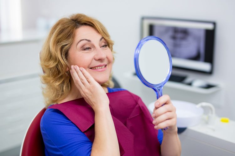 dentist Liverpool, NY bigstock-Cheerful-Mature-Woman-Looking-321934459-750x500 Services